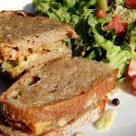 Reuben sandwich with a salad.