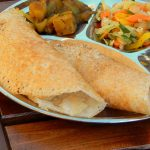 Plate of dosas with fillings.