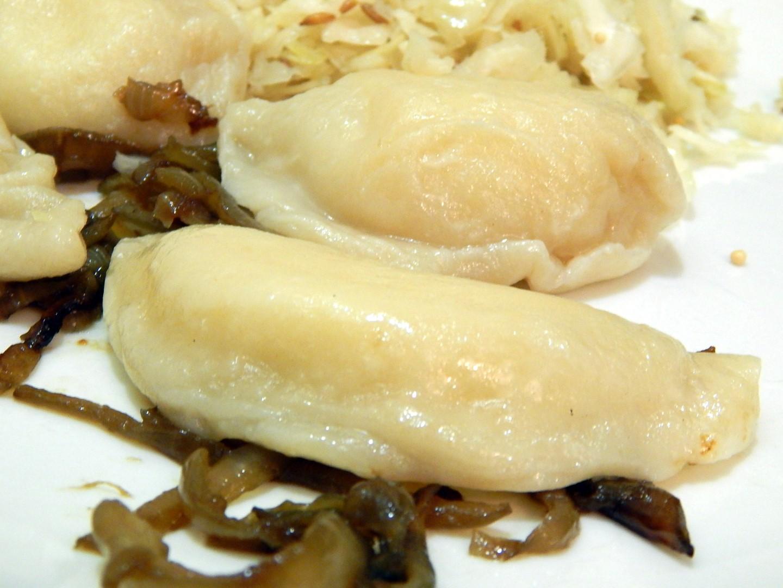 Plate of Homemade Pierogies and sauerkraut