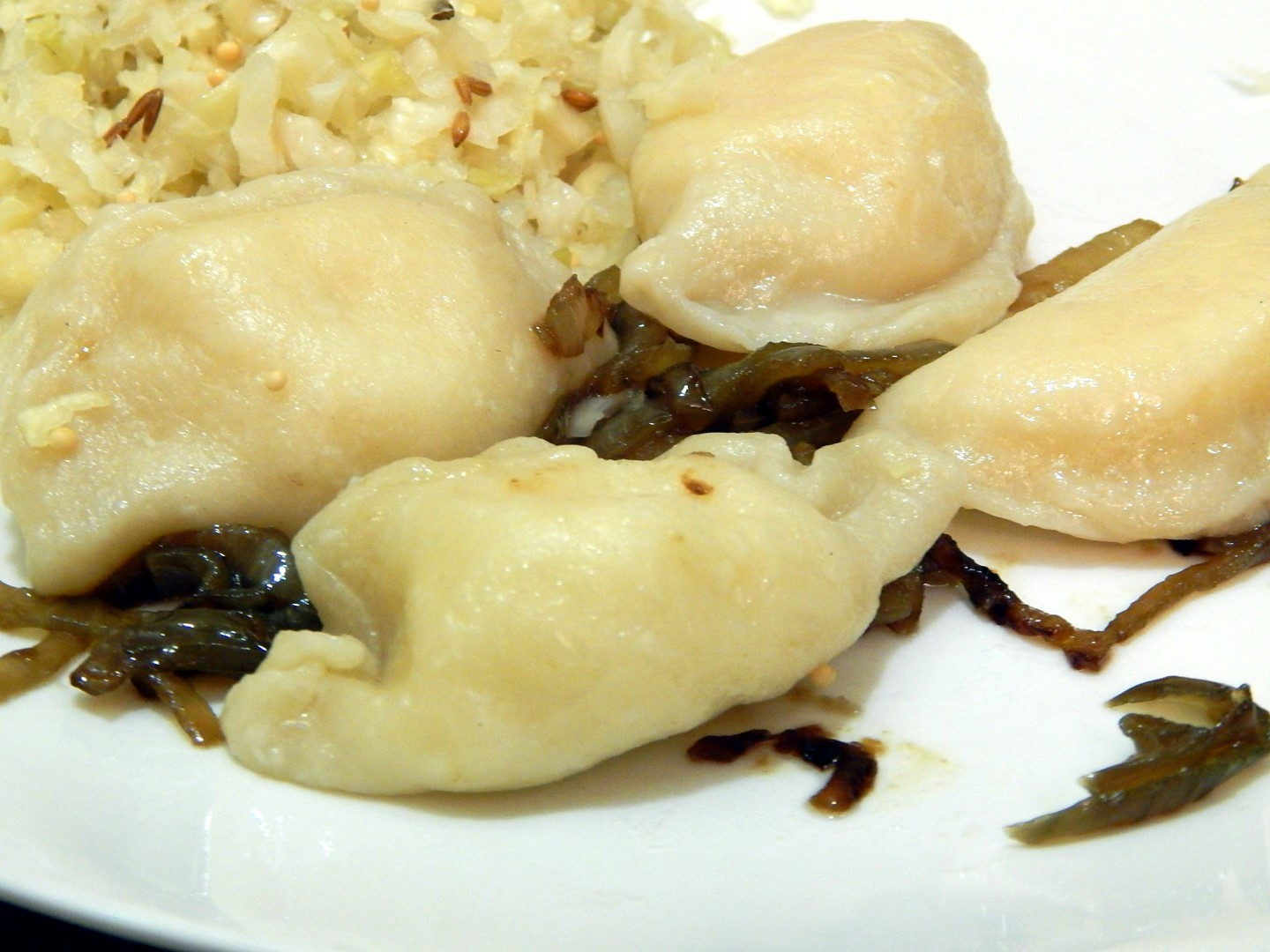 Plate of Homemade Pierogies and sauerkraut