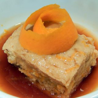Slice of semolina cake with orange peel and honey syrup.