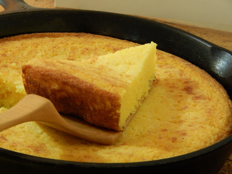 Corn bread in a cast iron skillet.