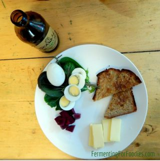 Salt brined eggs with toast, cheese and pickled beets.