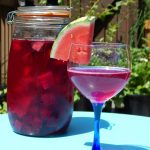 Sweet beet kvass with a slice of watermelon.
