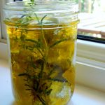 Mason jar with cheese balls in olive oil with herbs.