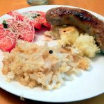Quick fried sauerkraut with sausage and tomatoes
