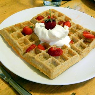 Sourdough waffle with strawberries and whipped cream