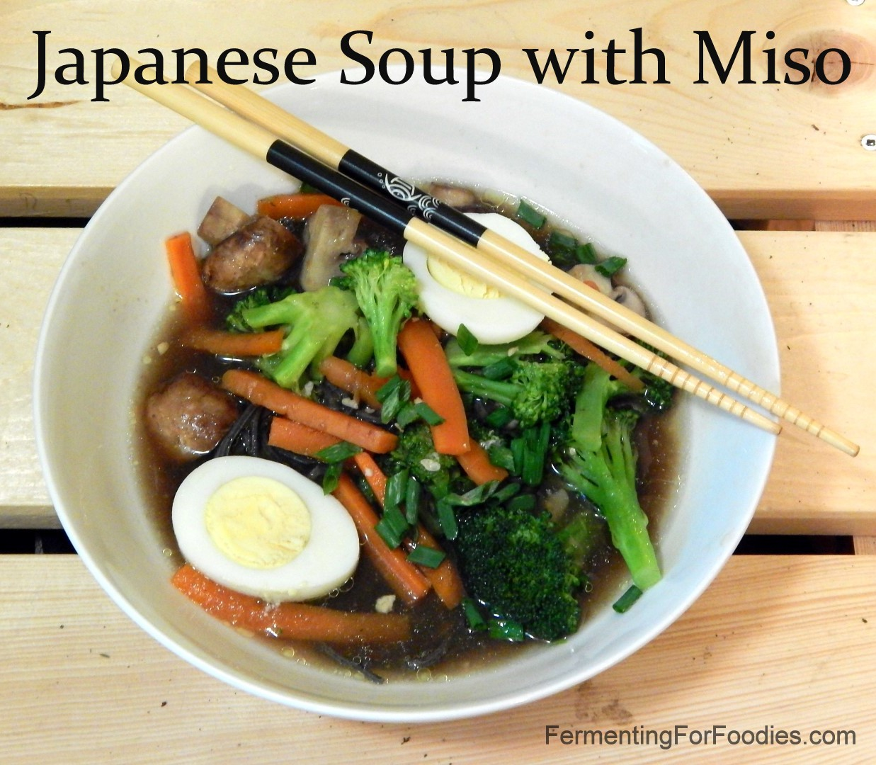Japanese noodle bowl with miso, eggs and vegetables.