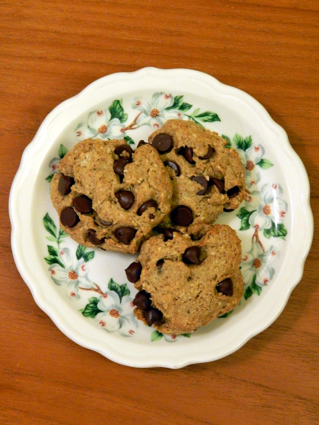 Plate with three chocolate chip cookies.