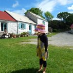 Little girl in front of Welsh farm house.
