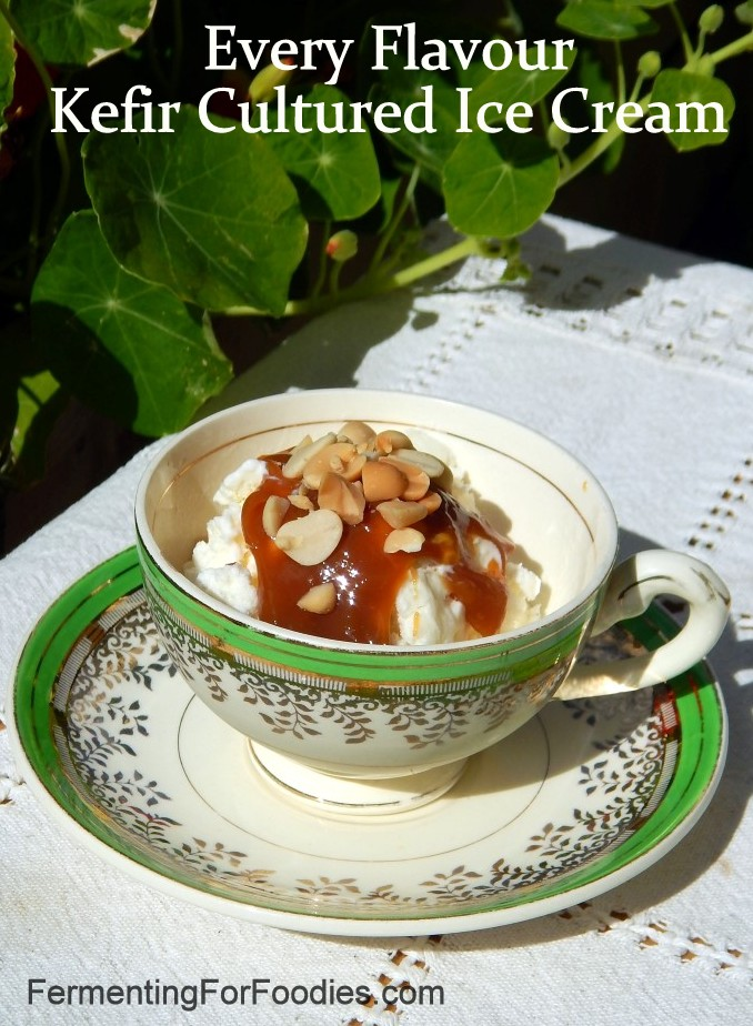 Tea cup of ice cream with caramel sauce and peanuts.