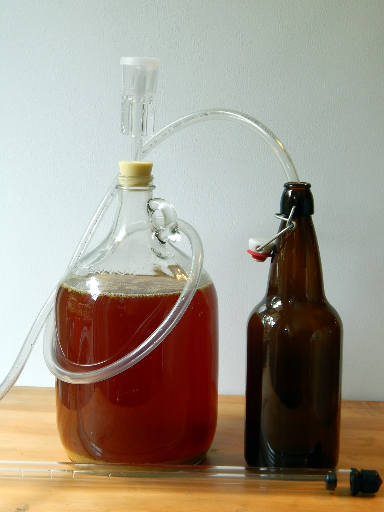 Carboy with hosing and bottle