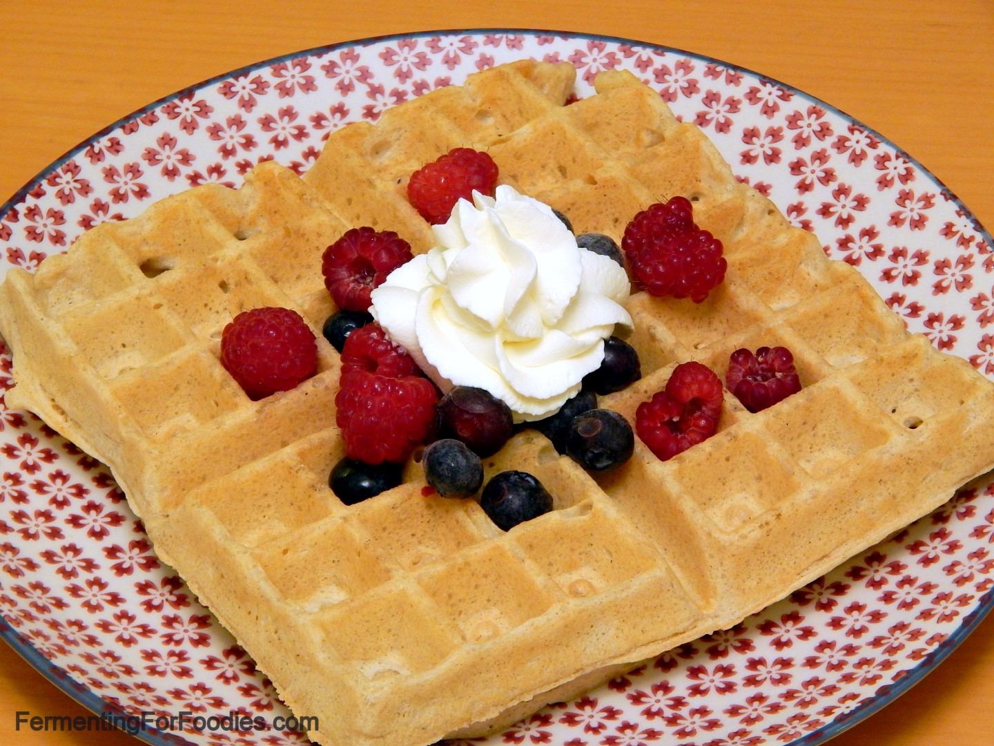 Gluten Free Sourdough Waffles with berries and whipped cream