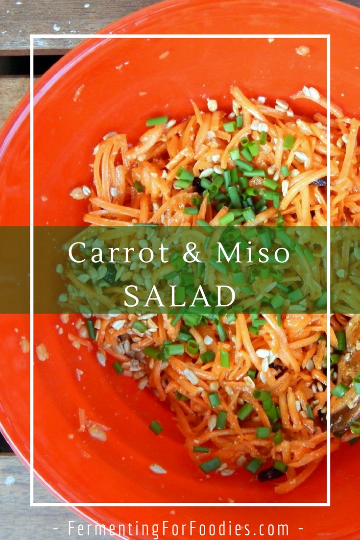 Carrot miso salad with sunflower seeds, raisins and chives