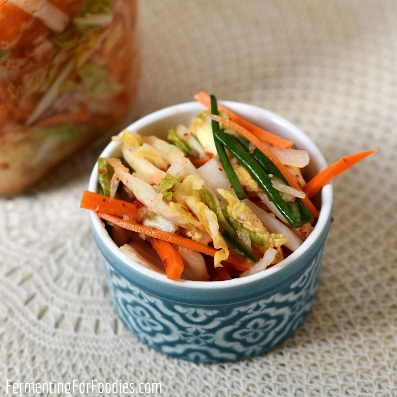 Simple and delicious vegan kimchi with daikon, napa cabbage and red pepper flakes