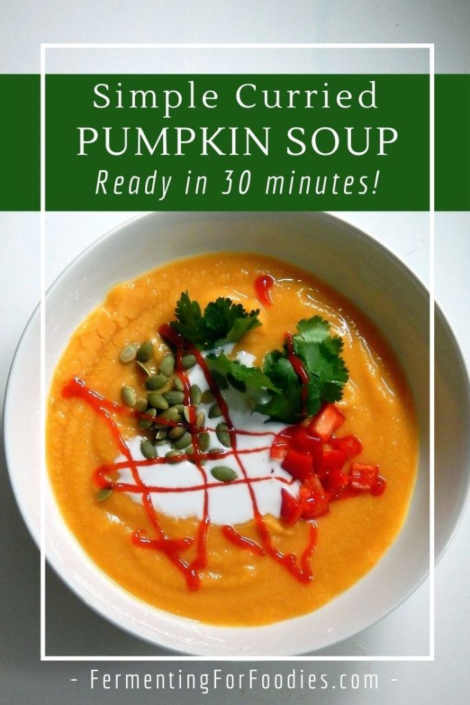 Vegan and gluten-free curried pumpkin soup with lentils and carrots